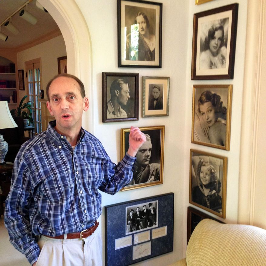 FILE - In tis Oct. 16, 2014 file photo Missouri Auditor Tom Schweich shows off some of the movie-star photos in his collection of autographed memorabilia from the golden age of Hollywood during at his home in Clayton, Mo. Schweich, a Republican candidate for governor, died Thursday Feb. 26, 2015 of a self-inflicted gunshot wound, a staff member told The Associated Press.  (By David A. Lieb, File)
