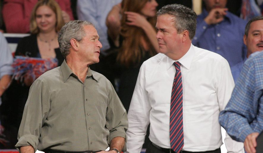 Former President George W. Bush jokes with his brother, former Florida Gov. Jeb Bush in Pensacola, Fla., in this file photo. (Associated Press) ** FILE **