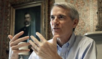Sen. Rob Portman, R-Ohio, speaks during an interview in Lebanon, Ohio, in this Monday, Oct. 13, 2014, file photo. (AP Photo/Al Behrman, File)