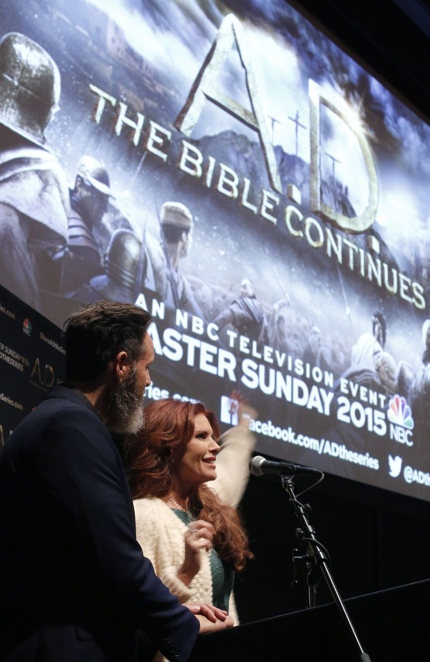 """Roma Downey, right, and Mark Burnett introduce episode one of the upcoming NBC series, """"A.D. The Bible Continues,"""" on Wednesday, Feb. 25, 2015, to a crowd of faculty and students at the Browning Theater on the University of Notre Dame campus in Notre Dame, Ind. (Al Goldis/AP Images for A.D. The Bible Continues)"""