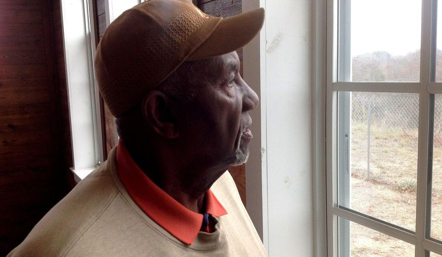 Raymond George looking out the window of the Mount Pleasant Colored School in Weatherford, Texas. The Mount Pleasant Colored School, which he attended as a youth, has been restored and will be on display Saturday, Feb. 28, 2015, as part of Black History Month.  (AP Photo/The Fort Worth Star-Telegram, Lance Winter)