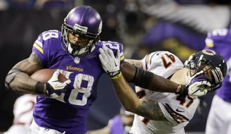 FILE - In this Dec. 1, 2013, fikle photo, Minnesota Vikings running back Adrian Peterson, left, tries to break a tackle from Chicago Bears free safety Chris Conte during the fourth quarter of an NFL football game in Minneapolis. A federal judge has cleared the way for Peterson to be reinstated. U.S. District Judge David Doty issued his order Thursday, Feb. 26, 2015, less than three weeks after hearing oral arguments. (AP Photo/Ann Heisenfelt, File)