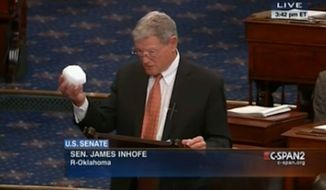"Oklahoma Sen. Jim Inhofe reportedly tossed a snowball Thursday on the Senate floor while arguing against ""the hysteria on global warming."" (C-SPAN2 via National Journal)"