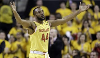 Maryland guard/forward Dez Wells gestures toward fans in the second half of an NCAA college basketball game against Wisconsin, Tuesday, Feb. 24, 2015, in College Park, Md. Wells contributed a game-high 26 points to Maryland's 59-53 upset win. (AP Photo/Patrick Semansky)