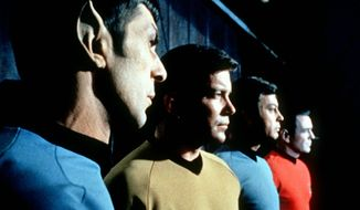 """This undated file photo shows actors in the TV series """"Star Trek,"""" from left, Leonard Nimoy as Commander Spock, William Shatner as Captain Kirk, DeForest Kelley as Doctor McCoy and James Doohan as Commander Scott. Nimoy, famous for playing officer Mr. Spock in """"Star Trek"""" died Friday, Feb. 27, 2015 in Los Angeles of end-stage chronic obstructive pulmonary disease. He was 83. (AP Photo/Paramount Television ,File)"""