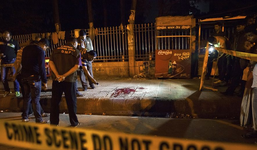 In this Thursday, Feb. 26, 2015, photo, Bangladeshi policemen investigate at the site of attack on Avijit Roy, in Dhaka, Bangladesh. Roy, a prominent Bangladeshi-American blogger, known for speaking out against religious fundamentalism was hacked to death in the streets of Bangladesh's capital as he walked with his wife, police said Friday. (AP Photo/Rajib Dhar) ** FILE **