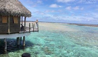 Tahitian overwater bungalow in Tikehau (Photo by Lark Gould)