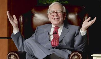 Billionaire investor Warren Buffett speaks in Omaha, Neb., at an event to raise money for the Girls Inc., charity organization, in this Nov. 14, 2011, file photo. (AP Photo/Nati Harnik, File)