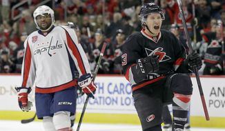 Carolina Hurricanes' Jeff Skinner (53) reacts following his goal against the Washington Capitals as Capitals' Joel Ward watches during the second period of an NHL hockey game in Raleigh, N.C., Friday, Feb. 27, 2015. Carolina won 3-0. (AP Photo/Gerry Broome)