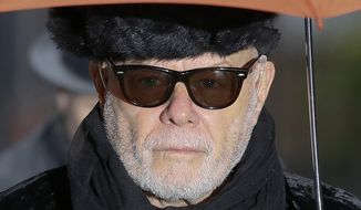 In this Thursday, Feb. 5, 2015, file photo, British pop star Gary Glitter, real name Paul Gadd, arrives at Southwark Crown Court in London. Gary Glitter has been jailed for 16 years for sexual assaults on three girls dating back to the 1970s. (AP Photo/Kirsty Wigglesworth) ** FILE **