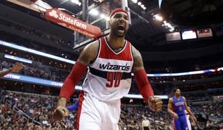Washington Wizards forward Drew Gooden (90) reacts after blocking a shot in the first half of an NBA basketball game against the Detroit Pistons, Saturday, Feb. 28, 2015, in Washington. (AP Photo/Alex Brandon)
