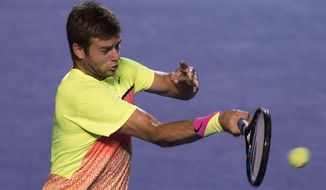 Ryan Harrison of U.S. returns the ball to David Ferrer of Spain during a Mexican Tennis Open semifinal match in Acapulco, Mexico, Friday, Feb. 27, 2015. (AP Photo/Christian Palma) **FILE**