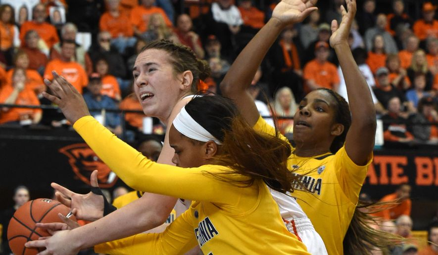California's Brittany Boyd, center, knocks a ball away from Oregon State's Ruth Hamblin, left, as California teammate Rashanda Gray helps defend during the first half of an NCAA college basketball game, Saturday, Feb. 28, 2015, at Gill Coliseum in Corvallis, Ore. (AP Photo/Albany Democrat-Herald, Mark Ylen)