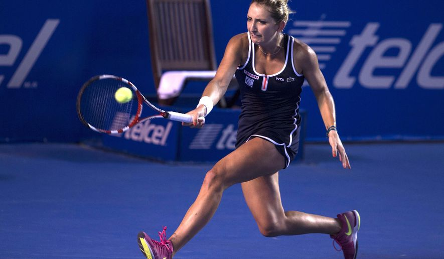 Timea Bacsinszky of Switzerland returns the ball to Caroline Garcia of France during the final of the women's singles of the Mexico Open tennis tournament in Acapulco, Saturday, Feb. 28, 2015. (AP Photo/Christian Palma)