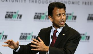 Louisiana Gov. Bobby Jindal speaks at the free market Club for Growth winter economic conference at the Breakers Hotel Saturday, Feb. 28, 2015, in Palm Beach, Fla.   (AP Photo/Joe Skipper)