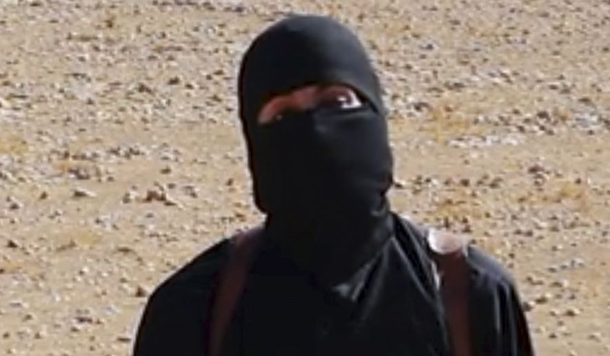 This undated image frame grab from a video released Friday, Oct. 3, 2014, by Islamic State militants shows the militant who beheaded taxi driver Alan Henning. (AP Photo, File)