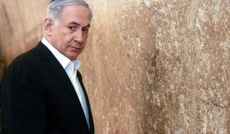Israeli Prime Minister Benjamin Netanyahu looks on before praying at the Western Wall, the holiest site where Jews can pray, in Jerusalem's Old City, Saturday Feb. 28, 2015. (AP Photo/Marc Sellem, Pool)