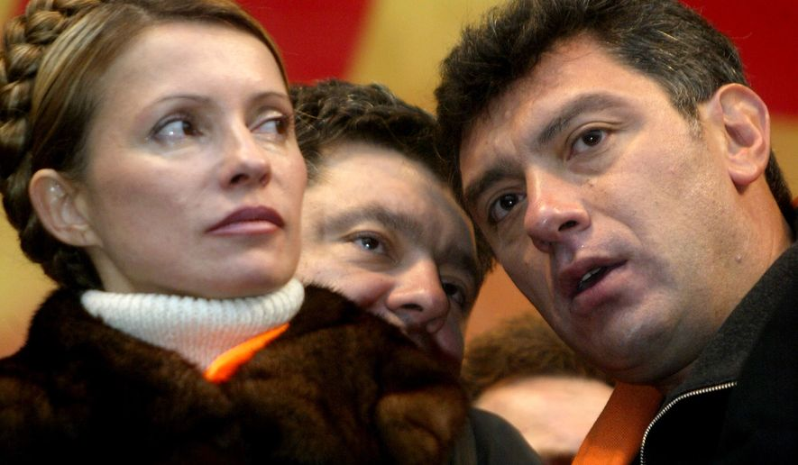 """[u""""FILE - In this file photo taken on Monday Nov. 22, 2004, Boris Nemtsov, a leader of the Russian Union of liberal party, right, listens to Petro Poroshenko,  while Yulia Tymoshenko, left, looks on during a street protest   in downtown Kiev Ukraine. Russia's Interior Ministry says Boris Nemtsov, a leading opposition figure and former deputy prime minister, has been shot and killed near the Kremlin. Nemtsov, a sharp critic of President Vladimir Putin, was killed early Saturday. His death comes just a day before a major opposition rally in Moscow. (AP Photo/Efrem lukatsky)"""", u'FILE - In this Nov. 22, 2004 file photo, Boris Nemtsov, a charismatic Russian opposition leader and sharp critic of President Vladimir Putin, right, listens to Petro Poroshenko while Yulia Tymoshenko, left, looks on during a street protest  in downtown Kiev Ukraine. Nemtsov was gunned down Saturday, Feb. 28, 2015 near the Kremlin, just a day before a planned protest against the government. (AP Photo/Efrem lukatsky)']"""