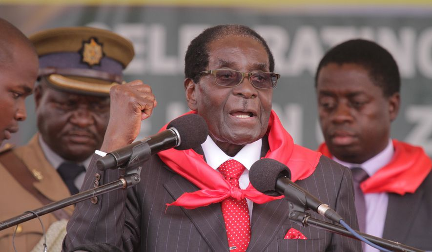 Zimbabwe President Robert Mugabe chants the party slogan during celebrations to mark his 91st birthday in the resort town of Victoria Falls, Saturday Feb, 28, 2015. Mugabe turned  91 on the 21st of February to become the worlds oldest leader with his supporters saying they will back him to run his full term until 2018 and beyond despite nagging questions about his health. (AP Photo/Tsvangirayi Mukwazhi)