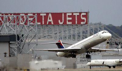 A Delta Airlines jet departs Hartsfield Jackson Atlanta International Airport in Atlanta on April 14, 2008. (Associated Press) **FILE**