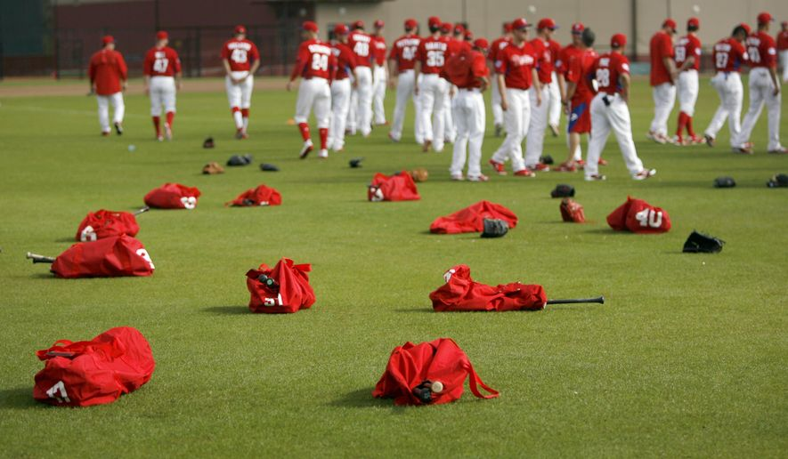 Equipment bags, belonging to Philadelphia Phillies pitchers and catchers, lay on the outfield of Schmidt Field on Monday, Feb. 23, 2015, as the players report to work out during the first day of Spring Training at the Carpenter Complex in Clearwater, Fla.    The first MLB spring training game of the season features the University of Tampa Spartans versus the Philadelphia Phillies at Clearwater's Bright House Stadium on Sunday, March 1, 1:10 p.m. (AP Photo/Tampa Bay Times/Douglas R. Clifford)     TAMPA OUT; CITRUS COUNTY OUT; PORT CHARLOTTE OUT; BROOKSVILLE HERNANDO TODAY OUT ; MAGS OUT