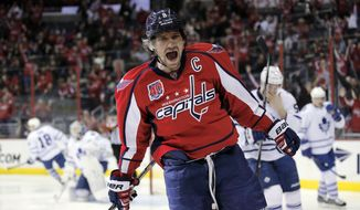Washington Capitals left wing Alex Ovechkin (8), from Russia, celebrates his goal in the first period of an NHL hockey game against the Toronto Maple Leafs, Sunday, March 1, 2015, in Washington. (AP Photo/Alex Brandon)