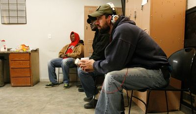 Workers, some who have been laid off or can't find jobs in the oil industry, wait for assignments at the Command Center temporary staffing agency in Williston, North Dakota. (Associated Press)