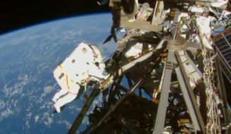 In this image from NASA television astronaut Terry Virts is seen during the third spacewalk outside the International Space Station Sunday March 1, 2015.  (AP Photo/NASA-TV)