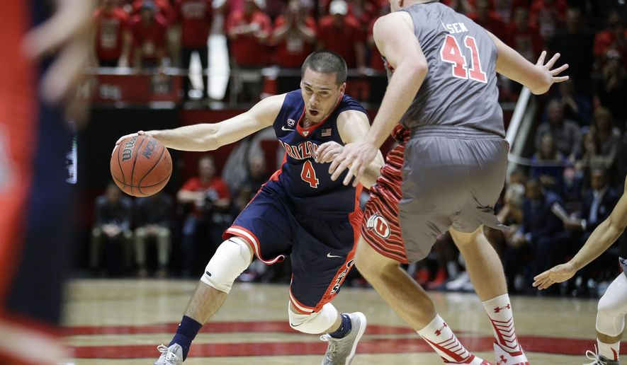 Arizona guard T.J. McConnell (4) drives around Utah forward Jeremy Olsen (41) in the first half of an NCAA college basketball game Saturday, Feb. 28, 2015, in Salt Lake City. (AP Photo/Rick Bowmer)