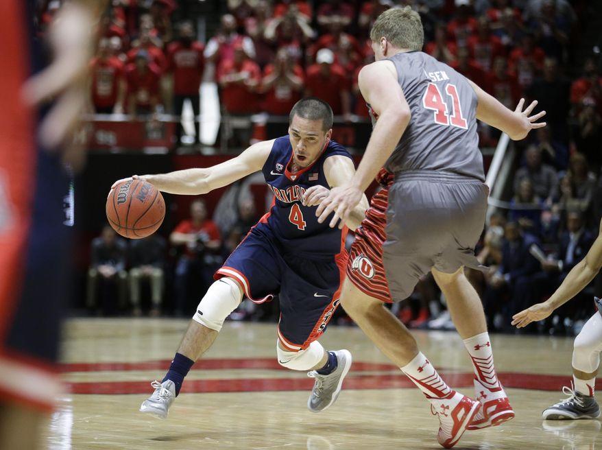 Arizona guard T.J. McConnell (4) drives around Utah forward Jeremy Olsen (41) in the first half of an NCAA college basketball game Saturday, Feb. 28, 2015, in Salt Lake City. (AP Photo/Rick Bowmer)