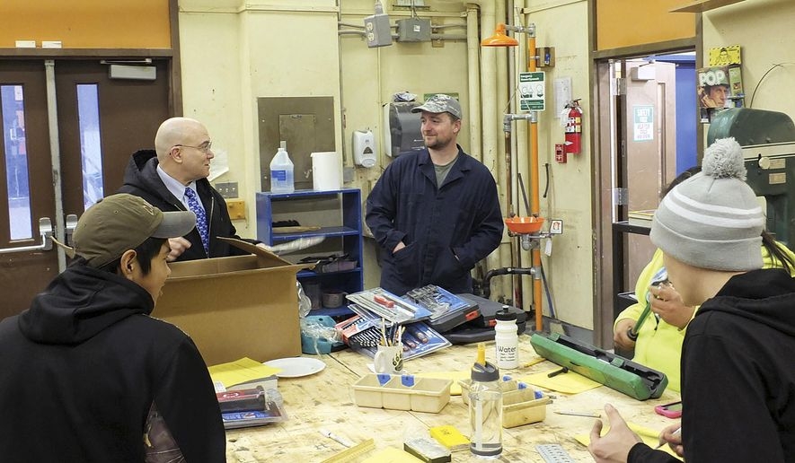 ADVANCE FOR SUNDAY MARCH 1 AND THEREAFTER In this Feb. 6, 2015 photo, Clinton Howard, from left, Principal Jim Parkin, Jared Williams, Ivanette Johnson and Duncan O'Brien look at tools just donated to the Angoon High School automotive class in Angoon, Alaska. In January, Angoon High School got a Department of Education and Early Development Perkins grant, intended for career and technical education, and started a trial program in two classes: intro to automotive, and small engine and outboard repair. (AP Photo/Capital City Weekly, Mary Catharine Martin)