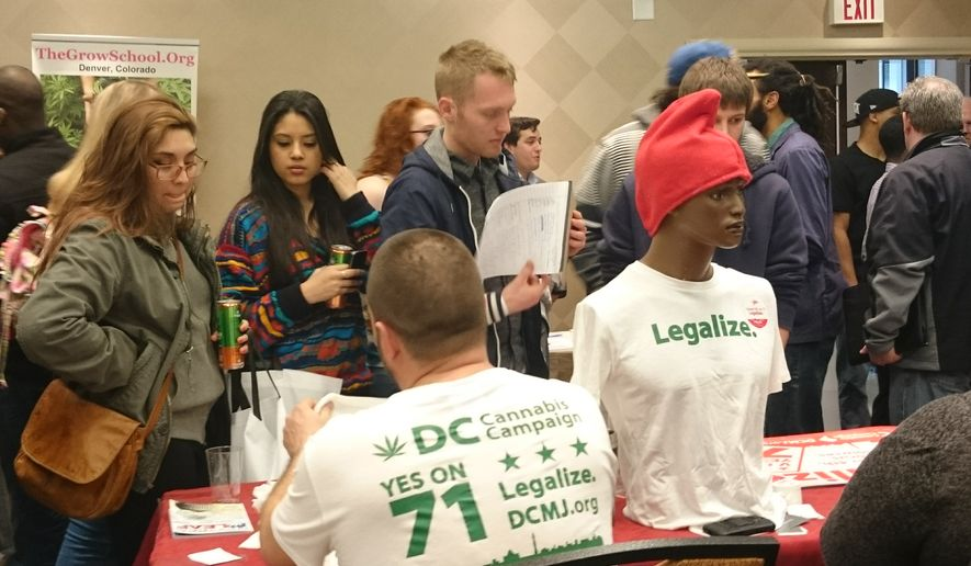 "Attendees at the ComfyTree ""Cannabis Academy"" held at the Holiday Inn Washington-Capitol Hotel in Southwest on Saturday and Sunday talk to marijuana legalization advocates. Photo by Andrea Noble / The Washington Times"