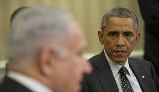 President Barack Obama listens as Israeli Prime Minister Benjamin Netanyahu speaks during their meeting in the Oval Office of the White House in Washington, Wednesday, Oct. 1, 2014. (Associated Press) ** FILE **