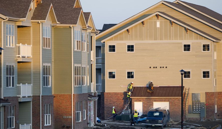 ADVANCED FOR RELEASE SUNDAY, MARCH 1, 2015 Construction continues on the Aventine Apartments Complex in Wilderness Hills in Lincoln, Neb. (AP Photo/Lincoln Journal, Eric Gregory)