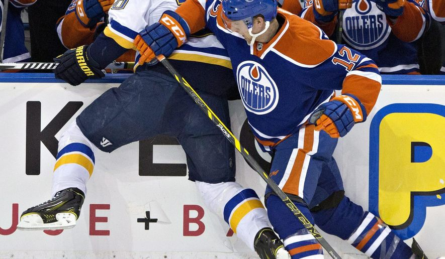 St. Louis Blues' Alexander Steen (20) is checked by Edmonton Oilers' Rob Klinkhammer (12) during second period NHL hockey action in Edmonton, Alberta, on Saturday Feb. 28, 2015. (AP Photo/The Canadian Press, Jason Franson)