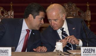 U.S. Vice President Joe Biden (right) listens to Honduran President Juan Orlando Hernandez during a press conference at the National Palace in Guatemala City on March 2, 2015. Biden is on a two-day trip to meet with the leaders of Guatemala, El Salvador and Honduras regarding immigration issues. (Associated Press)