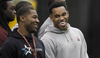 Former Minnesota line backer Damien Wilson, right, laughs with former Minnesota running back David Cobb, left, during Minnesota pro day in Minneapolis, Monday, March 2, 2015. (AP Photo/Ann Heisenfelt)