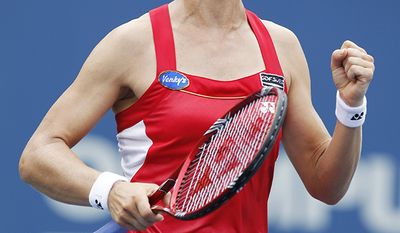 Elena Dementieva (former Atlanta Thrasher Maxim Afinogenov) of Russia runs to the net after beating Daniela Hantuchova of Slovakia 7-5, 6-2 at the U.S. Open tennis tournament in New York, Friday, Sept. 3, 2010. (AP Photo/Kathy Willens)