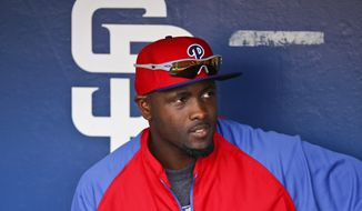 Philadelphia Phillies Tony Gwynn Jr. sits in the dugout prior to the baseball game against the San Diego Padres on Tuesday, Sept. 16, 2014, in San Diego. (AP Photo/Don Boomer)