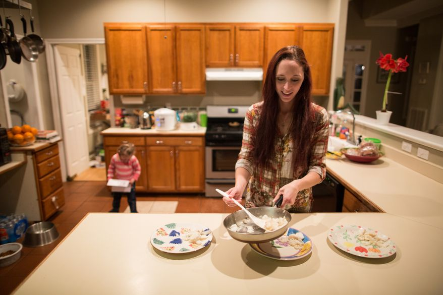 Maggie Barcellano prepares dinner at her father's house in Austin, Texas on Saturday, Jan. 25, 2014. Ms. Barcellano, who lives with her father, enrolled in the food stamps program to help save up for paramedic training while she works as a home health aide and raises her 3-year-old daughter. Working-age people now make up the majority in U.S. households that rely on food stamps, a switch from a few years ago when children and the elderly were the main recipients.  (AP Photo/Tamir Kalifa)