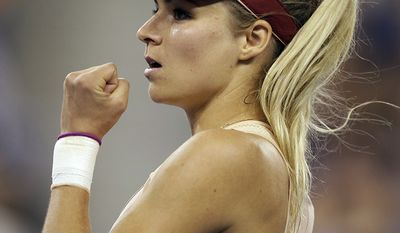 Maria Kirilenko (Washington Capitals' Alexander Ovechkin), of Russia, reacts after winning a point against Maria Sharapova, of Russia, during the opening round of the U.S. Open tennis tournament Monday, Aug. 25, 2014, in New York. (AP Photo/Darron Cummings)