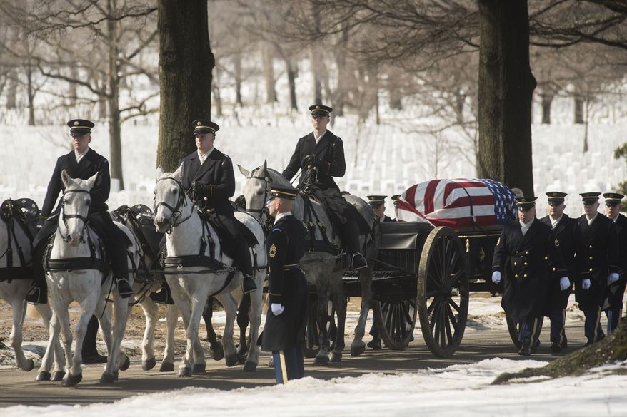 A caisson carries the remains of U.S. Army Air Force Tech Sgt. Charles Johnston, and airman missing from World War II, Monday, March 2, 2015, during burial services at Arlington National Cemetery in Arlington, Va. Johnston died on April 10, 1944 when his B-24 was shot down over New Guinea.  (AP Photo/Kevin Wolf)