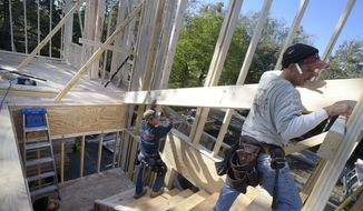 In this Feb. 13, 2015 photo, construction workers James Gibson, left, David Rager, center, and Shawn White frame the second floor of a two-story custom home being built in Orlando, Fla. As construction jobs return in some regions, competition for skilled labor is heating up. (AP Photo/Phelan M. Ebenhack) ** FILE **