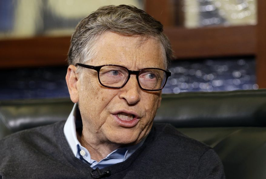 In this May 5, 2014, file photo, Microsoft co-founder and Berkshire Hathaway board member Bill Gates speaks during an interview with Liz Claman on the Fox Business Network in Omaha, Neb. (AP Photo/Nati Harnik, File)