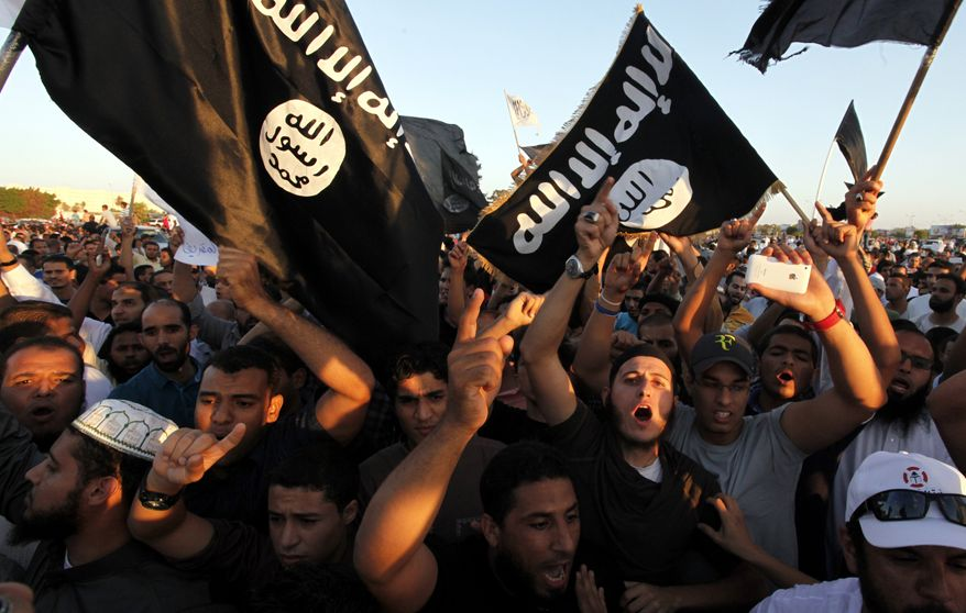 Libyan followers of Ansar al-Shariah Brigades and other Islamic militias hold a demonstration on Sept. 21, 2012, against a film and a cartoon denigrating the Prophet Muhammad in Benghazi. (Associated Press) **FILE**