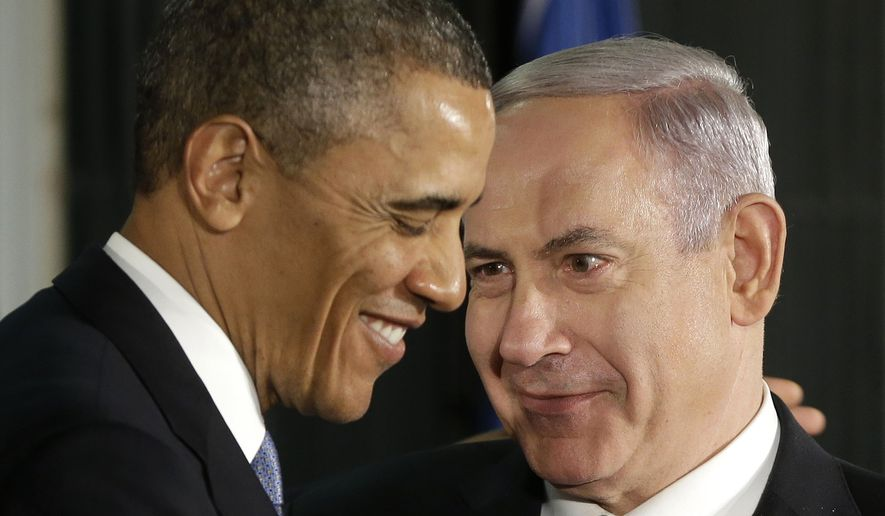 In this March 20, 2013, file photo, President Barack Obama and Israeli Prime Minister Benjamin Netanyahu huddle during their joint news conference in Jerusalem, Israel. (AP Photo/Pablo Martinez Monsivais, File) **FILE**