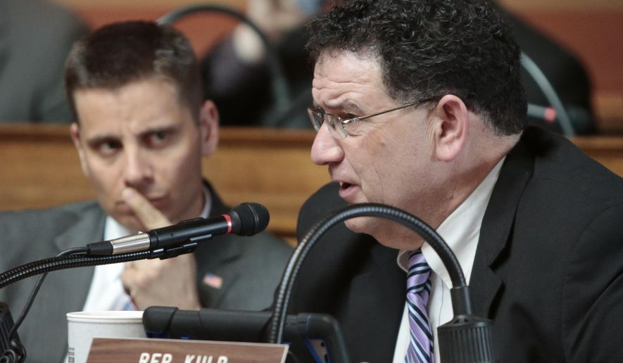 Wisconsin Rep. Bob Kulp, R-Stratford, asks a question of a person providing testimony during a public hearing of the Assembly labor committee regarding Right to Work legislation at the State Capitol in Madison, Wis., Monday, March 2, 2015. Listening, left, is Wisconsin Rep. Chris Kapenga, R-Delafield. (AP Photo/Wisconsin State Journal, M.P. King)