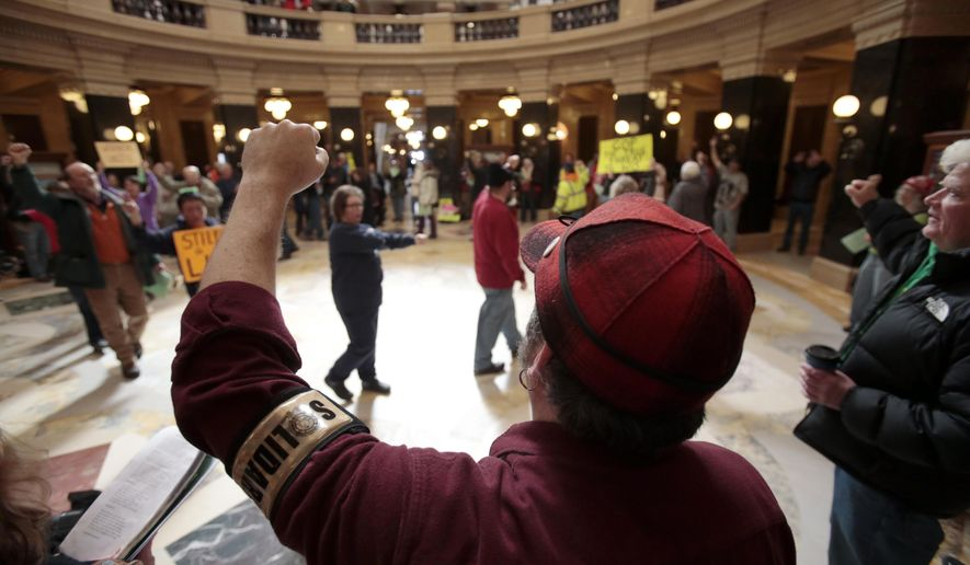 Solidarity Singers protest Right to Work legislation in the rotunda at the State Capitol in Madison, Wis., Monday, March 2, 2015. (AP Photo/Wisconsin State Journal, M.P. King)