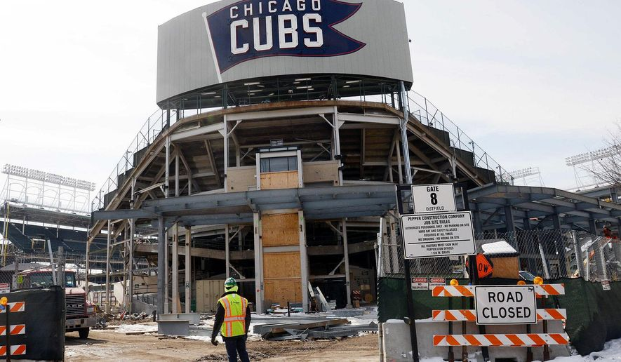Construction continues while the Chicago Cubs' press forward on renovations to Wrigley Field as opening day approaches Monday, March 2, 2015, in Chicago. The Cubs officials plan to ask the city for permission to work around the clock to speed up Wrigley Field renovations.  (AP Photo/Daily Herald, Bob Chwedyk) MANDATORY CREDIT; MAGS OUT