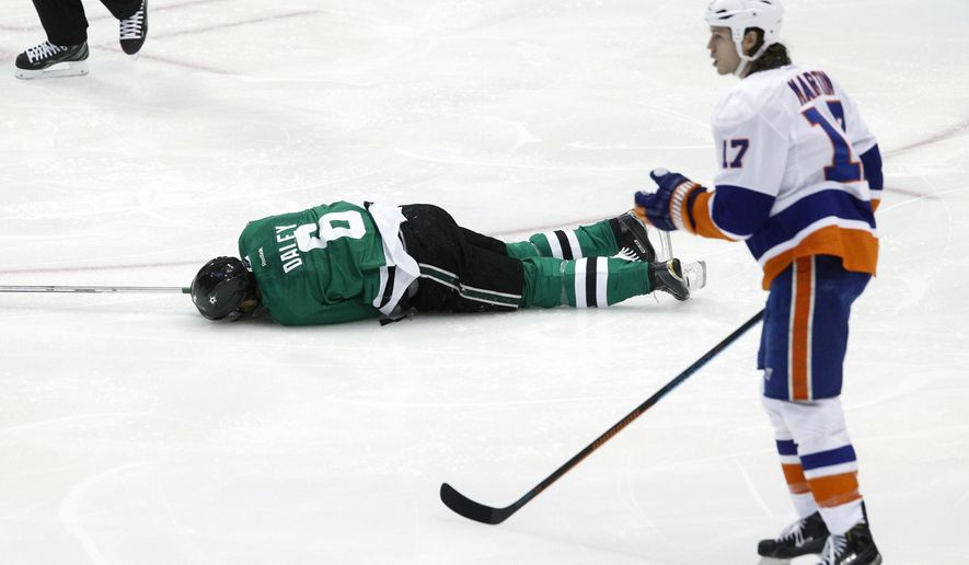 Dallas Stars defenseman Trevor Daley (6) lies face down on the ice after being hit by New York Islanders left wing Matt Martin (17) in the first period of an NHL hockey game Tuesday, March 3, 201,5 in Dallas. Martin was penalized for kneeing. (AP Photo/Tim Sharp)